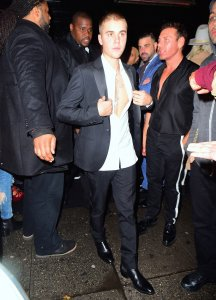 Justin Bieber was spotted leaving Up&Down nightclub in New York City, New York on May 3, 2016 after the Met Gala. The pop singer who is currently on tour, stepped out of the club wearing a navy blazer and white shirt unbuttoned all the way, showing off his cross chest tattoo. Pictured: Justin Bieber Ref: SPL1274533  030516   Picture by: 247PAPS.TV / Splash News Splash News and Pictures Los Angeles:310-821-2666 New York:212-619-2666 London:870-934-2666 photodesk@splashnews.com